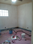 Living room with 1 coat of primer