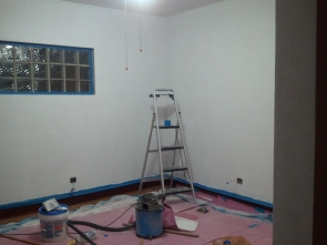 Living room with 2nd coat of primer (1)
