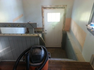 The old spray foam and plaster prepped for the casing.
