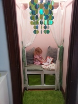 Olive jumped in to test out her reading nook. [Olive approved!]