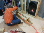 Enjoying the fire while building the frame