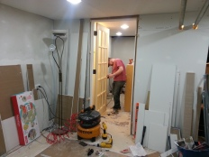 Installing the glass door.