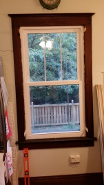 Window installed, with the spray foam drying.